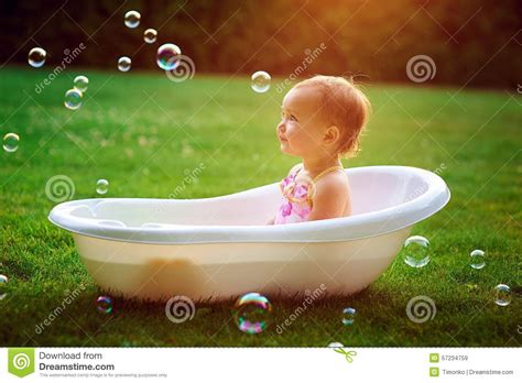girl bathes   bath  soap bubbles stock photo