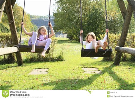 swing a little more kids girls on swing stock photo image 45676574