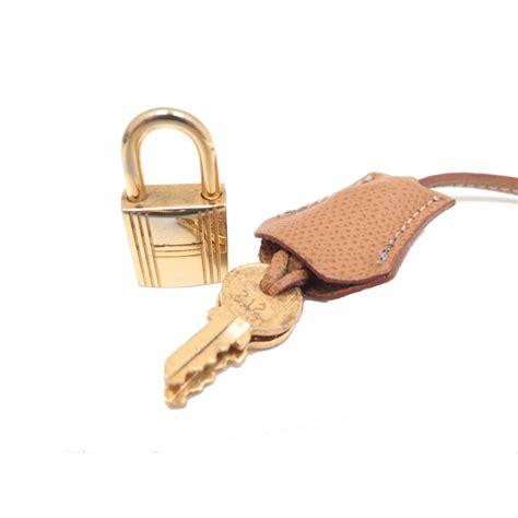 cadenas pour sac hermes cadenas tirette clochette hermes en cuir epsom gold