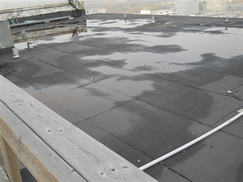 flat roof critical considerations for replacing a flat roof