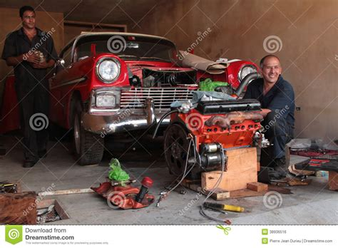 4 Car Garage Plans by Repair Of A Classic Old American Car In A Garage