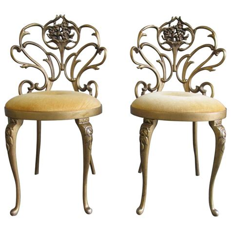 hollywood regency chair pair of cast iron hollywood regency chairs at 1stdibs