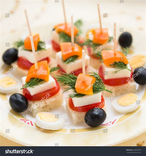 solde canapes cold snacks canapes feta cheese vegetables stock photo