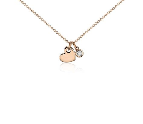and charm pendant in 14k gold 1 20 ct