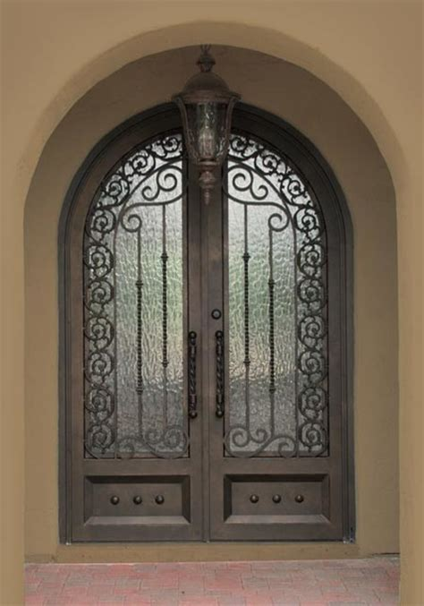 Iron Gates For Front Doors Iron Entry Doors Mediterranean Exterior By Colletti Design Iron Doors