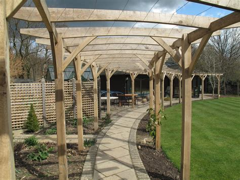 traditional oak pergola with curved beams more photos