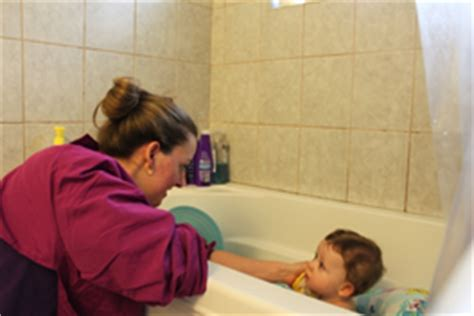 mom and son in bathroom mom protect your clothing from your kids koobli review