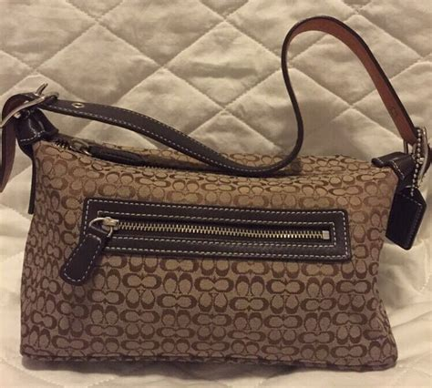 coach womens brown monogram signature small baguette hand