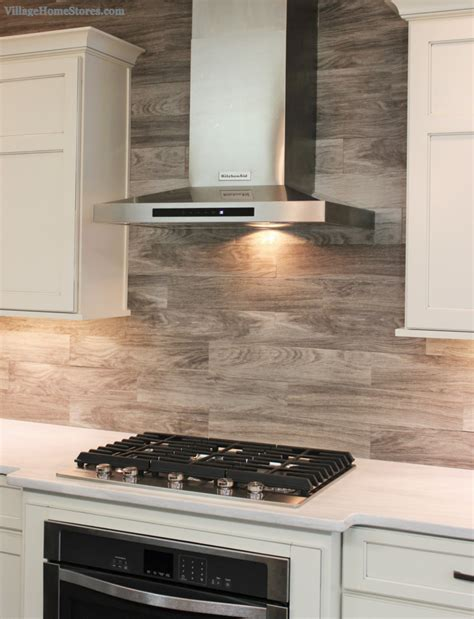 tiles and backsplash for kitchens porcelain floor tile with a gray woodgrain pattern is installed as a backsplash in this