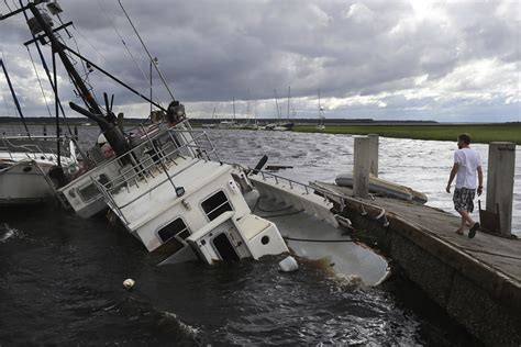 shrimp boat ashore in daytona aircraft carrier is rushed to the hurricane battered keys
