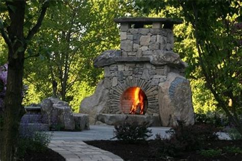 unique stone table with fireplace completing outdoor july 2014 lakeandhomes com