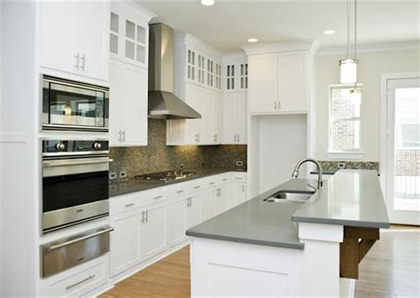 Grey Kitchen Cabinets With White Countertops by White Cabinets With Gray Quartz Countertops For Kitchen