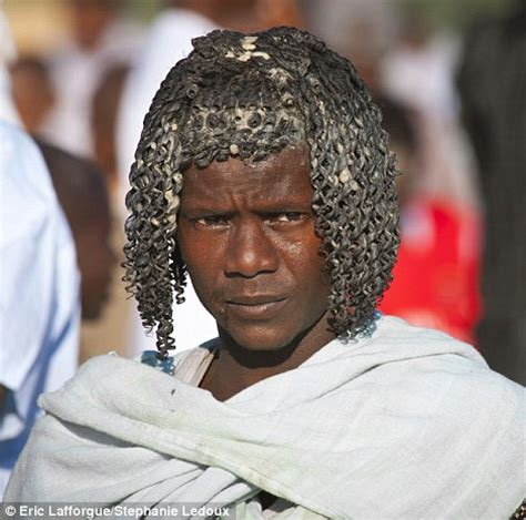pictures of ethnic futuristic haircut for men the ethiopian tribes who use butter to style their hair