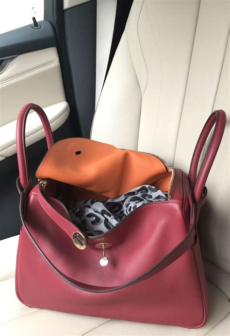 Hermes Lindy 7 112 hermes lindy 30 grenat and orange with permabrass