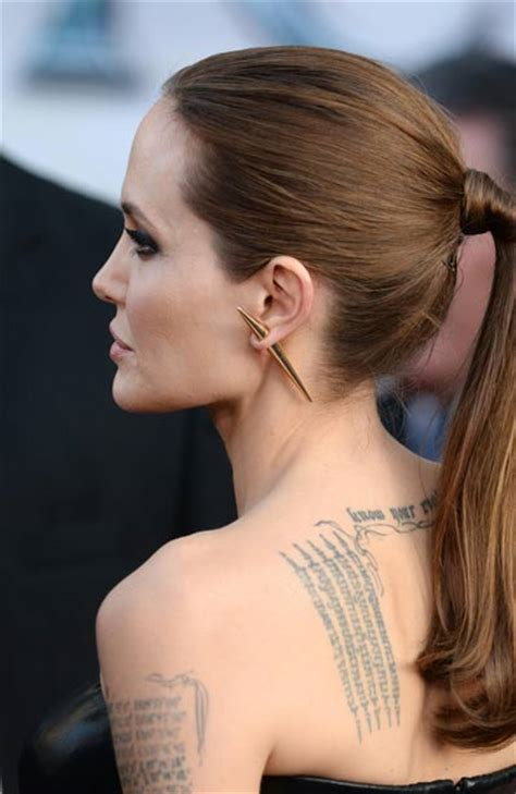 angelina jolie tattoo temple brangelina attend quot maleficent quot premiere emirates 24 7