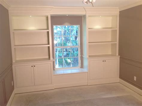 window seat flanked by bookcases 49762d1345862217 lower cabinets bookcases flanking