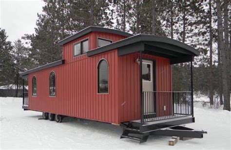 bespoke park model rv home built from a caboose