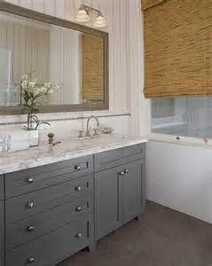 gray cabinets in bathroom grey vanity with framed mirror and marble counter