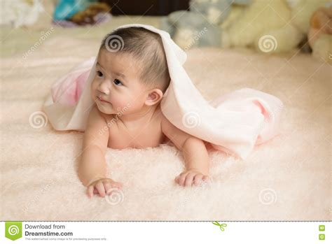 laid on the bed happy asian child lay on bed stock photo image 71976132