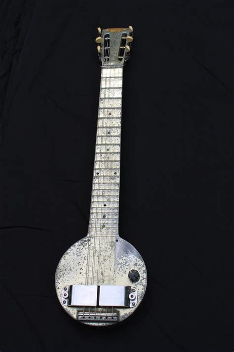 Electric Steel Guitar the electric guitar a steel frying pan guitar