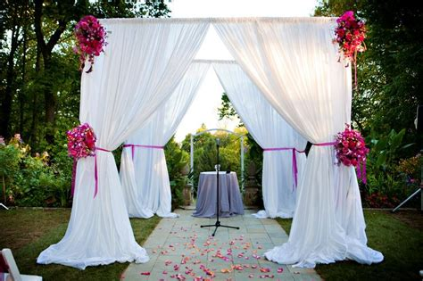 draped chuppah chuppah with white fabric and flowers wedding arches and