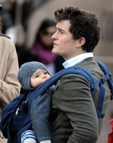 orlando bloom baby orlando bloom carries his baby son flynn in a baby carrier