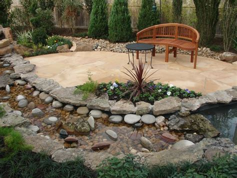 Creek Rock Patio by Landscaping With Oversize Pavers And Backyard Creek Hkns