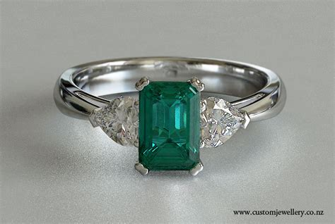 three emerald and white gold
