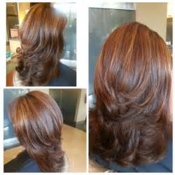 below shoulder simple layered hair style medium length hair cut with layers blown out with big