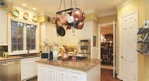 kitchen yellow walls white cabinets pot rack for the home pinterest
