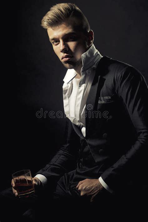 man holding collar  elegant violet formal suit jacket stock photo image  speaker haircut