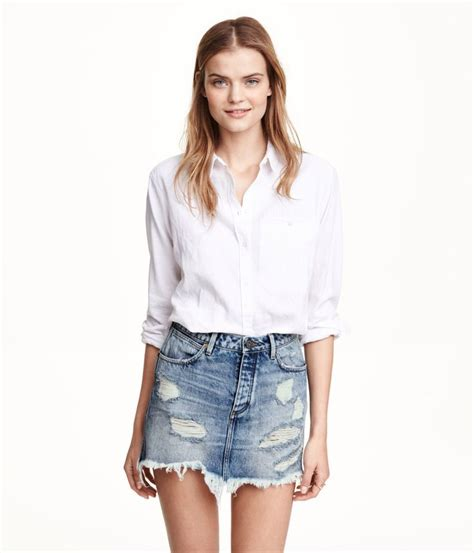 distressed denim mini skirt with pockets edge hem