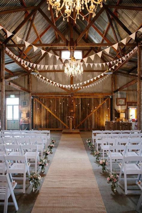 romantic indoor barn wedding decor ideas  lights