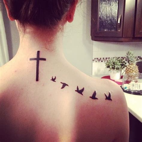 flying birds and cross back tattooshunt