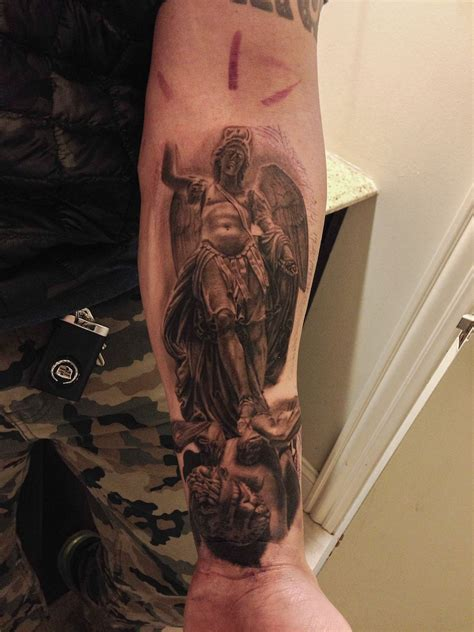 michael angel tattoo st michael the archangel statue done by manny abadi