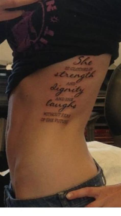 she is clothed in strength and dignity tattoo quot she is clothed in strength and dignity and she laughs