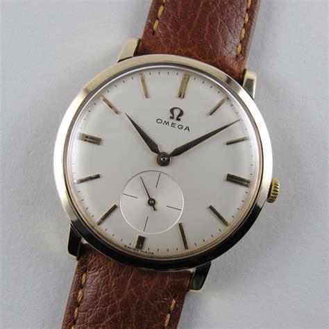gold omega vintage wristwatch hallmarked 1960 black