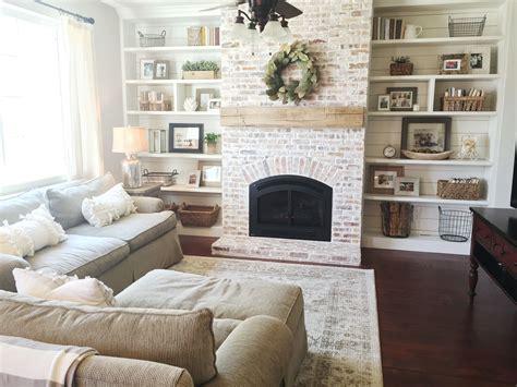 shiplap over brick built ins shiplap whitewash brick fireplace bookshelf