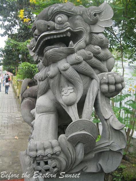 district tattoo manila chinese lion statue along jones bridge manila my