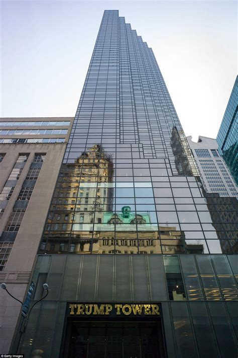 pictures of trump tower man is trying to scale trump tower on fifth avenue in nyc
