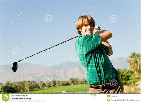 swinging videos free happy male golfer swinging golf club royalty free stock