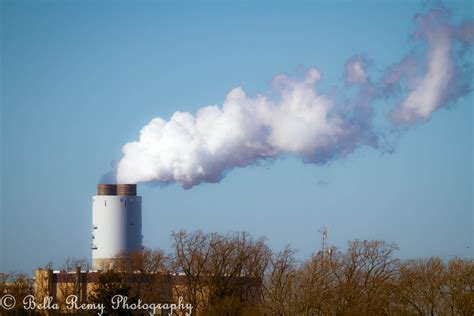 Fireplace Smoke by Smoke Stack On A Clear Day