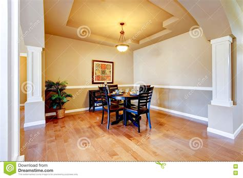 decke beige spacious dining room with white columns and beige tray