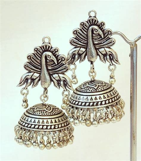 Home Decor Artificial Flowers by Buy Tribal German Silver Jhumka Earring Online