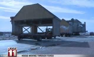 fargo house stops traffic as it makes it s way the