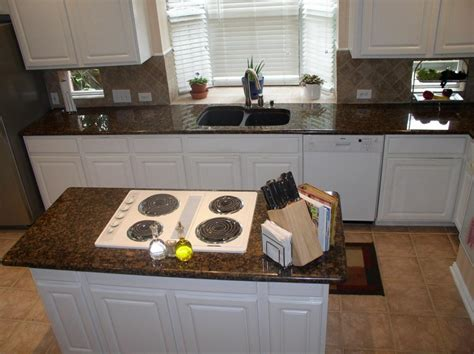 Brown Countertops White Cabinets by Brown Granite Countertops With White Cabinets Www