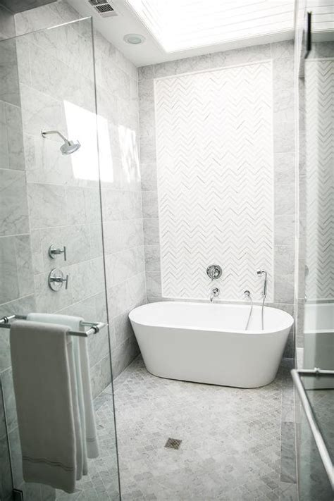 bathrooms set to become more hi tech in future white and gray marble chevron inset shower tiles