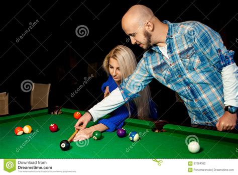 pool table to play helps a to play pool on the billiard table stock