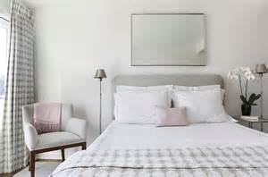 gray headboard with white and pink hotel bedding