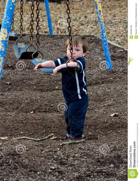 play boy swing videos sad little boy at the playground stock photo image 56450146